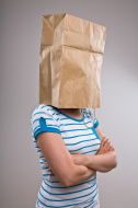stock-photo-6532201-woman-with-paper-bag-on-her-head